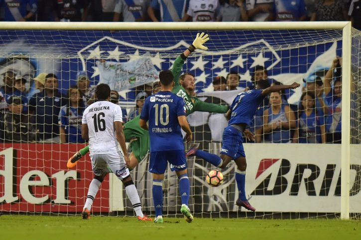 Emelec's Carlos Orejuela (R) scores a goal against Melgar from Peru d